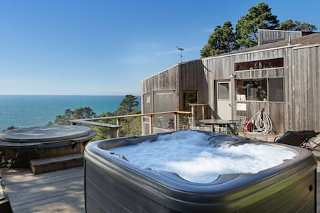 Dog-friendly, hillside home w/ oceanview, private hot tub, & shared pools/saunas