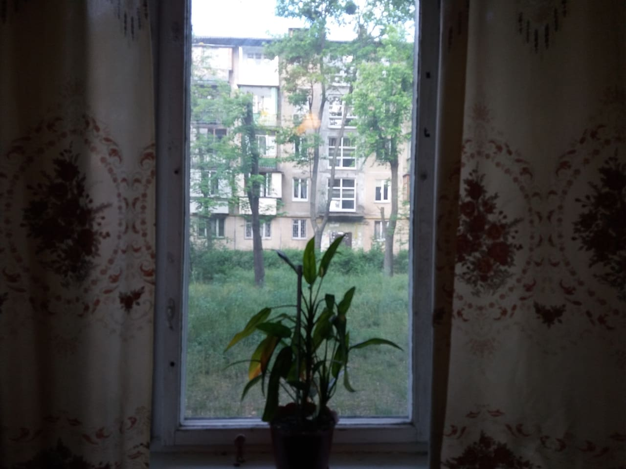 Bedroom. The window faces another identical five-storey building