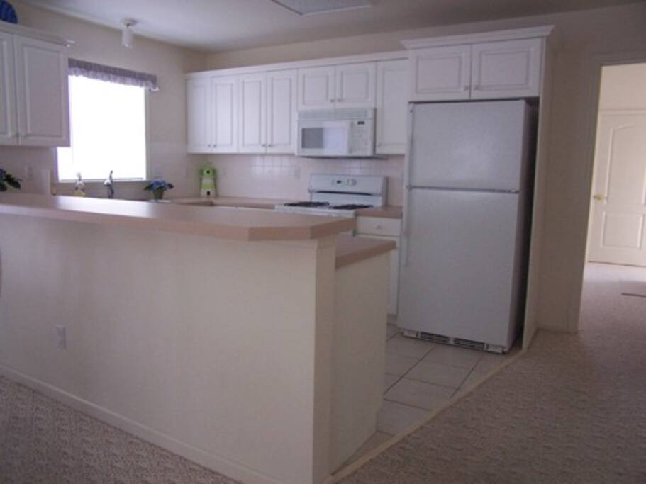 Full Kitchen, Oven, Dishwasher, Stove, Refrig, Garbage Disp. Buffet Counter, Microwave, Lots of Cabinets
