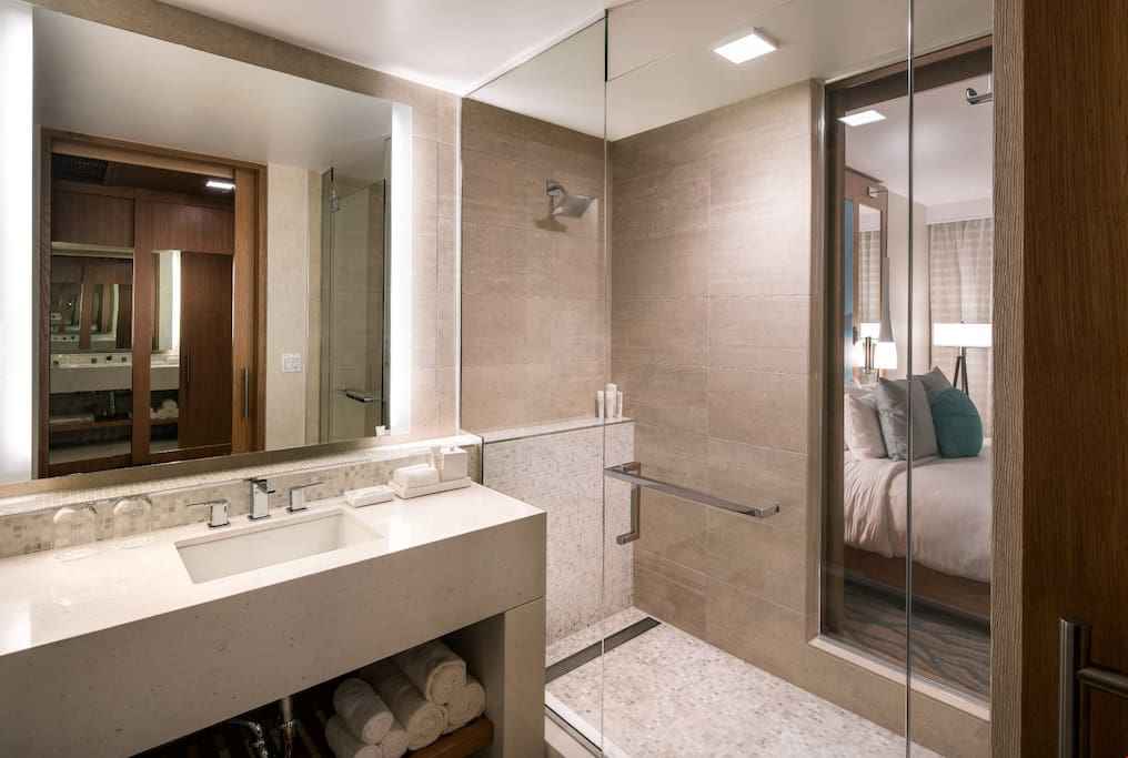 The spacious and modern bathroom features a walk-in shower