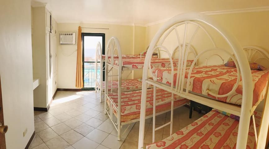This room is in the middle has 3 bunker beds and extra mattresses. With a shower room as well