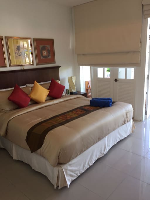 bedroom with aircon, fan and kingsize bed