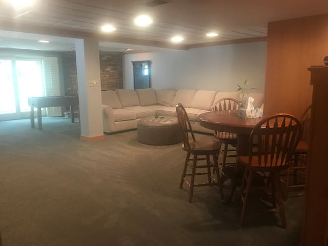 Living area with plenty of comfortable seating as well as a pub table with seating for four.