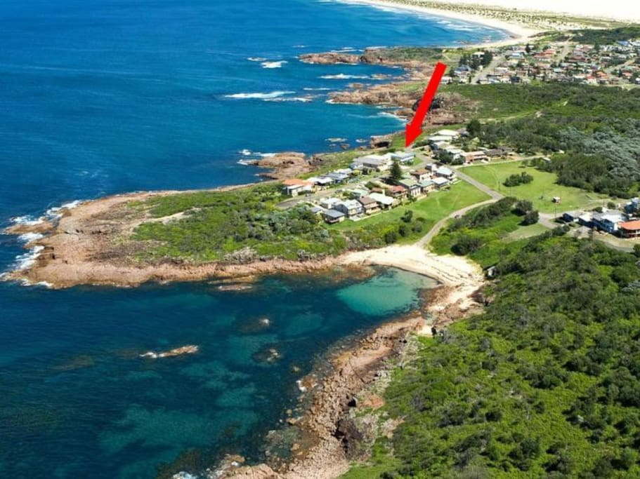 Aerial view of Fishermans Bay with our house marked. As you can see we are surrounded by the Pacific Ocean and Tomaree National Park.