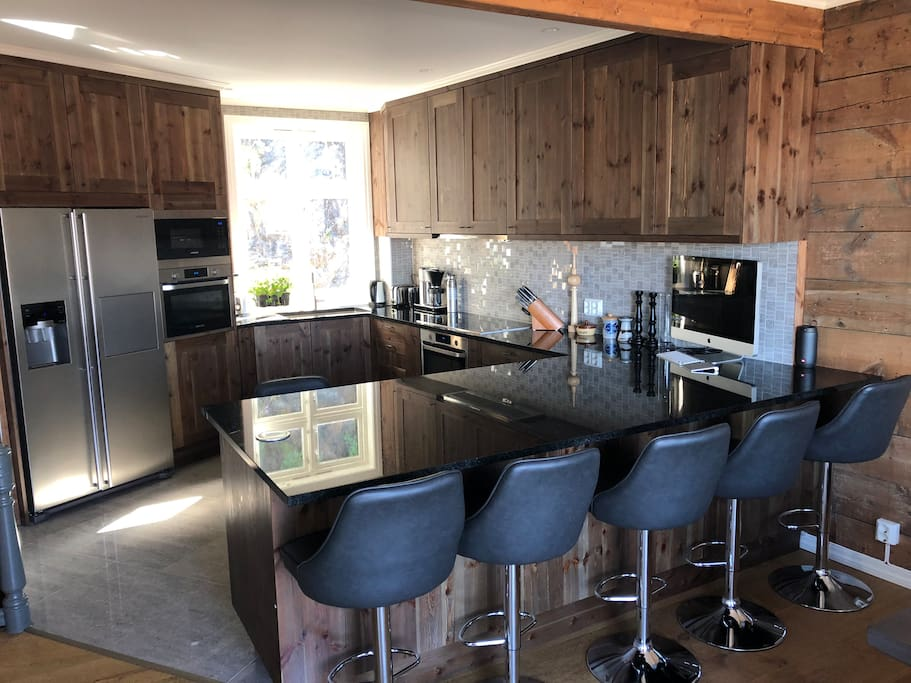 Full kitchen w/ double oven, micro, etc. granite countertops (locally sourced) Cabinets are repurposed from 150yr old original wood floors
