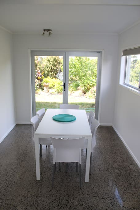 Dining table sits up to 6 with a nice view of the garden