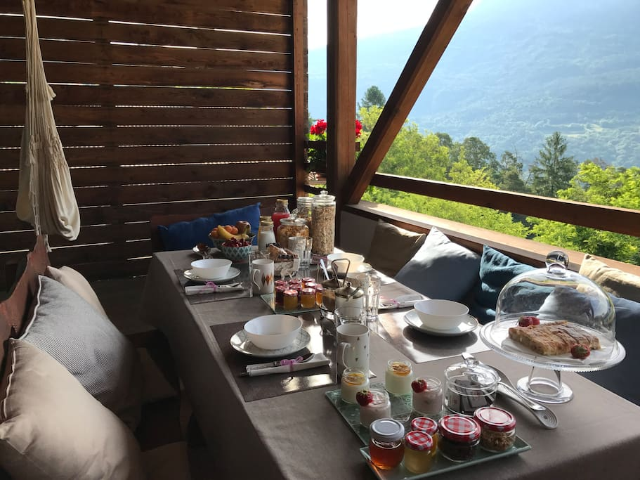 Breakfast on terrace over the forest