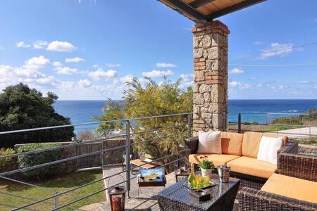 VillaNikolas stone house with stunning sea view.