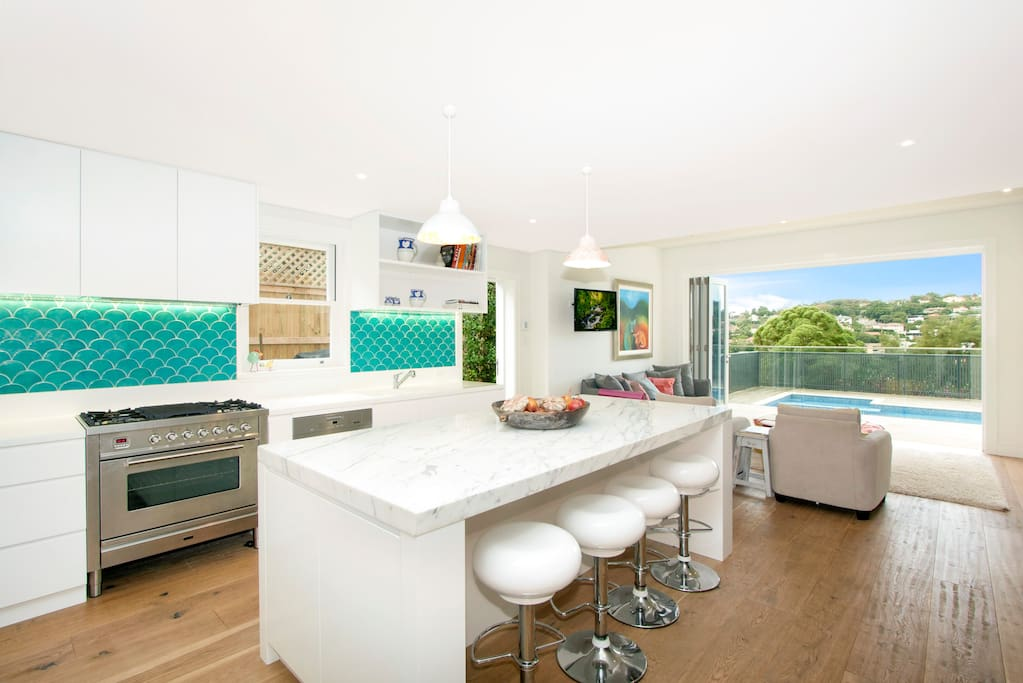 Immaculate renovated kitchen with casual living and dining areas adjoined