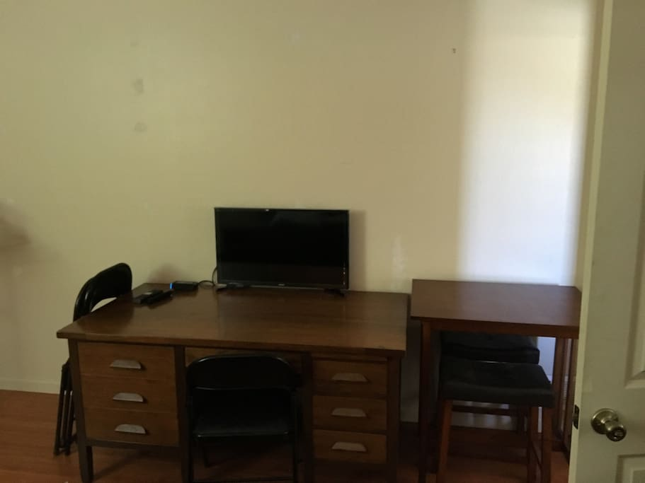 Office desk with drawers. On top is a full cable TV.