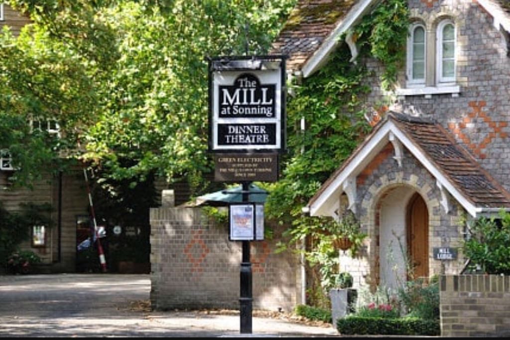 The cottage exterior with the Mill Theatre behind