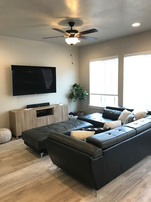 "Living Room: 65"" 4K curved TV with DirectTV"