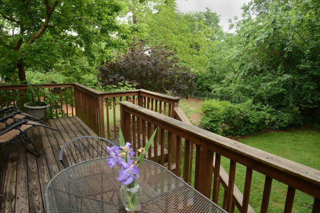 Private deck overlooks large greenspace.