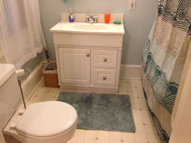 Bathroom has claw-footed tub with shower