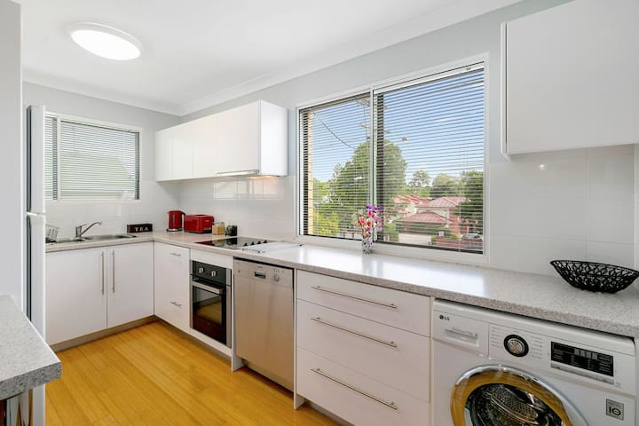 The clever, modern kitchen includes dishwasher and a washing machine for easy laundry requirements. A clothes dryer is also available.