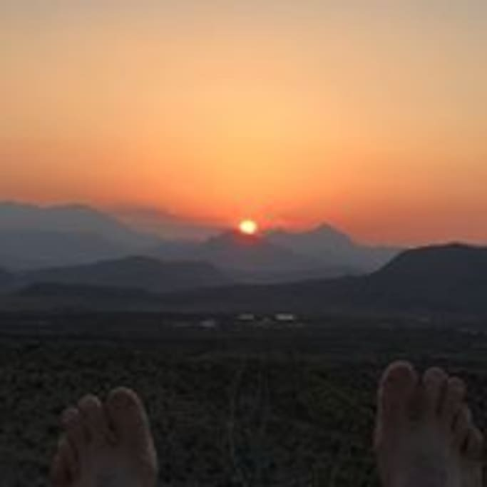 Springtime sunrise on the Christmas Mountains- and my feet!