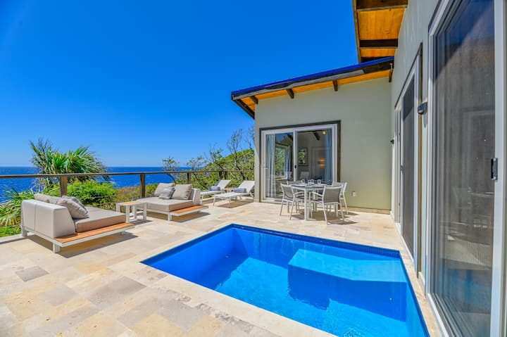 Villa Topaz Above West Bay with 180 Degree Views!