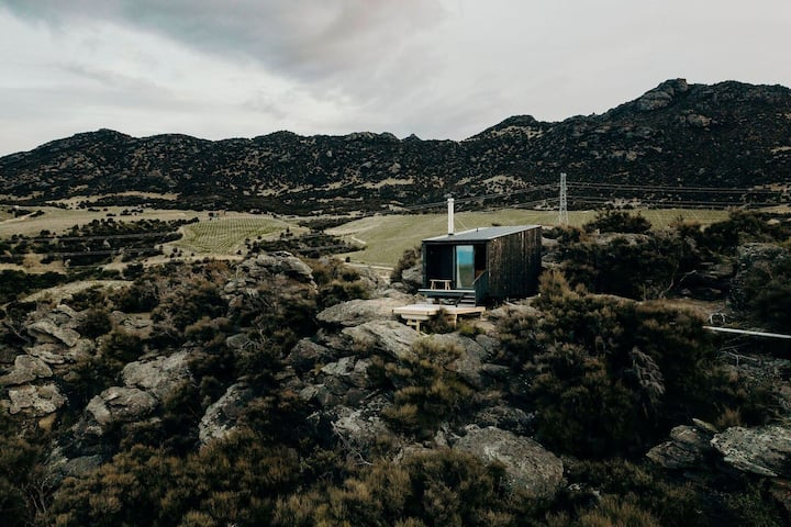 Dunstan Cabin on a hill in the heart of Central