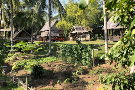 On The Mekong Resort:  A Pristine Village Home