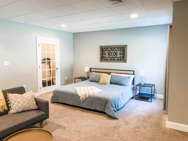 Comfortable king size bed. USB charging ports located in each bedside lamp. ***Please note that the treadmill is no longer here.