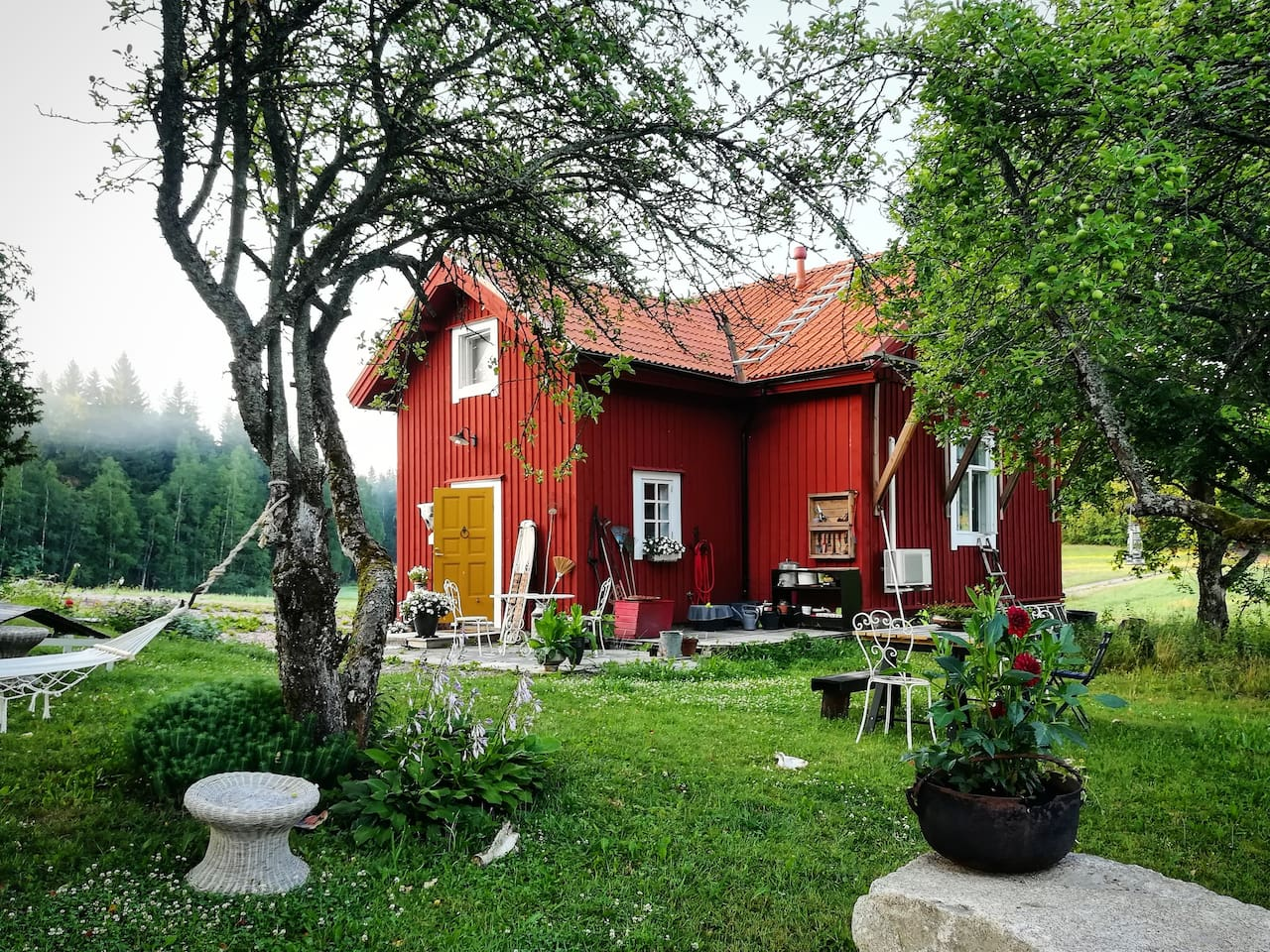 This is my home. It was built 1900 and totally renovated 5 years ago. The red color is typical in the Finnish countryside. In the garden there is a pergola and a table under the old apple trees, two hammocks and some rest chairs.