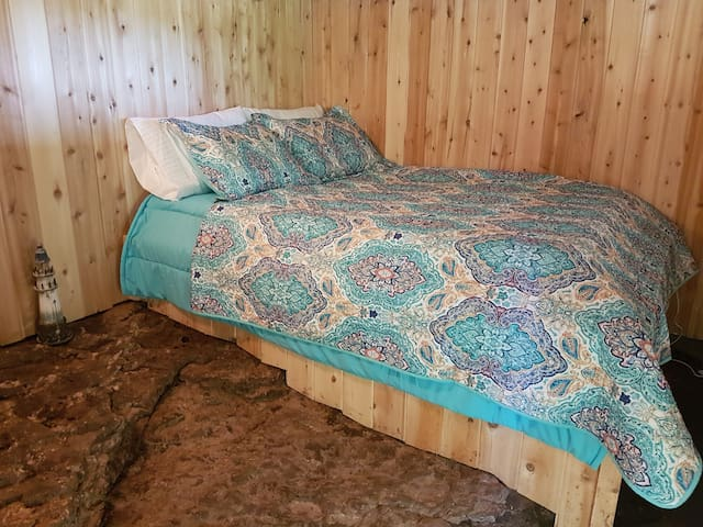 Bedroom 3 - Ground Floor - Rock Room - bed built on top of the ancient rock as a unique style, separate entrance with no access to 2nd floor. Only for Rock fans!  No negative comments please and thank you!