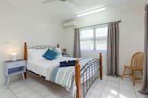 Large and airy queen bedroom with air-conditioning, lots of storage space and comfy queen bed with all linen included.
