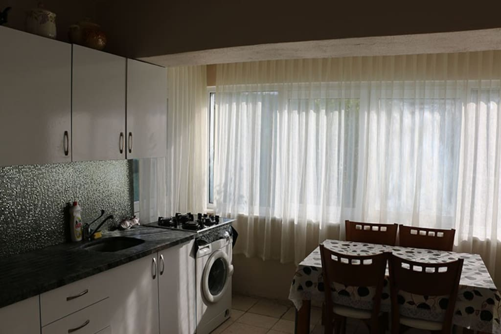 Kitchenette is equiped with fridge, oven, kettle, washing machine and utensils.