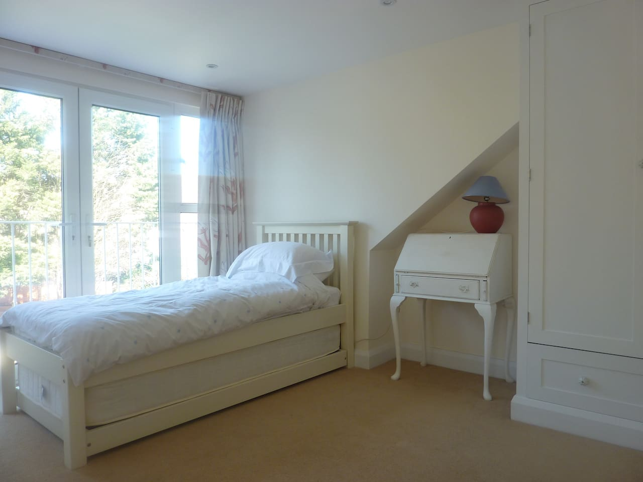 Single or twin bedroom with full length French doors overlooking garden