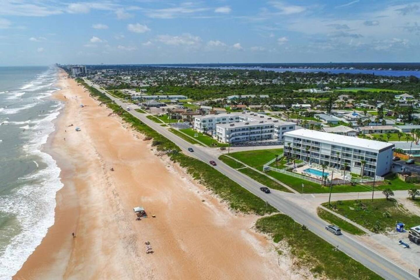 Aerial view of condo located directly on highly desirable Ocean Shore Blvd. This gorgeous condo offers direct views of the ocean from the main floor living space, patio and the master bedroom and deck.