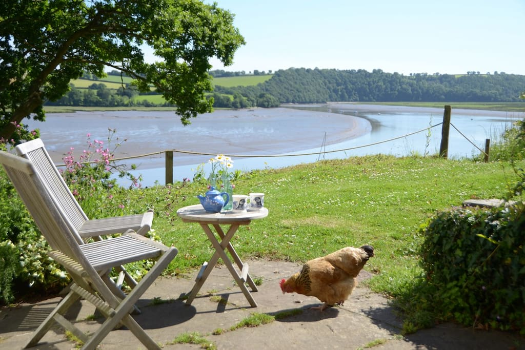 A sunny, secluded terrace to relax on with wonderful views of the river.