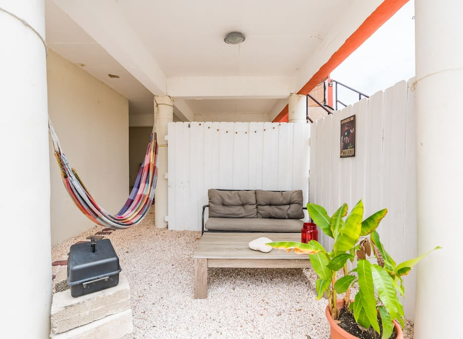 Privately closed off space for guaranteed privacy with a two person hammock and BBQ. Faces the back wall of of property (nature conservation zone) and our bird feeder.