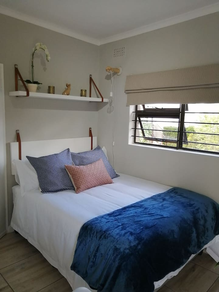 Very comfortable queen sized bed with white crisp white sheets for a good night's sleep.