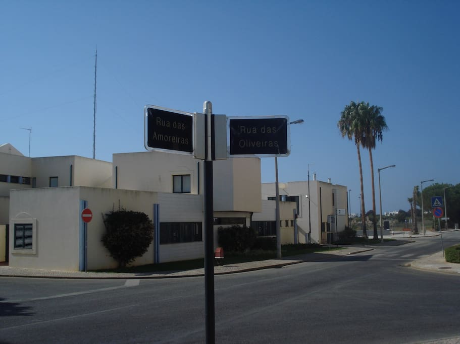 Street sign where Condominium is located. Local Police Station in the background