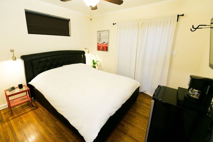 Queen size bed with plush down comforter