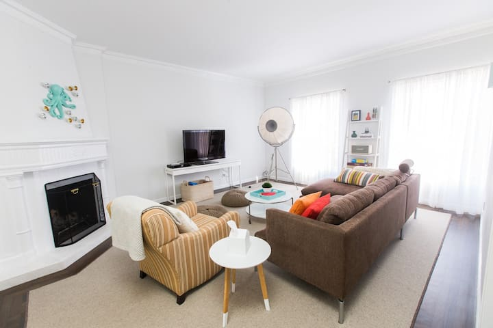 Living room - Stocked with Apple TV, DVDs and Marshall sound system. Furnished with classic Fortuny floor lamp and Walter Knoll sofa. Low-pile wool carpets throughout the flat.