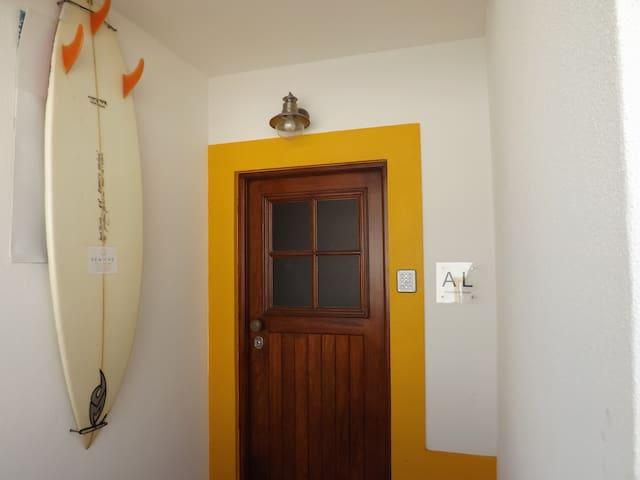 Peniche Chill House front door! Featuring the one and only 'Guga's surfboard!' / A porta de entrada do Peniche Chill House! Com a grande e única 'Prancha de surf do Guga'!