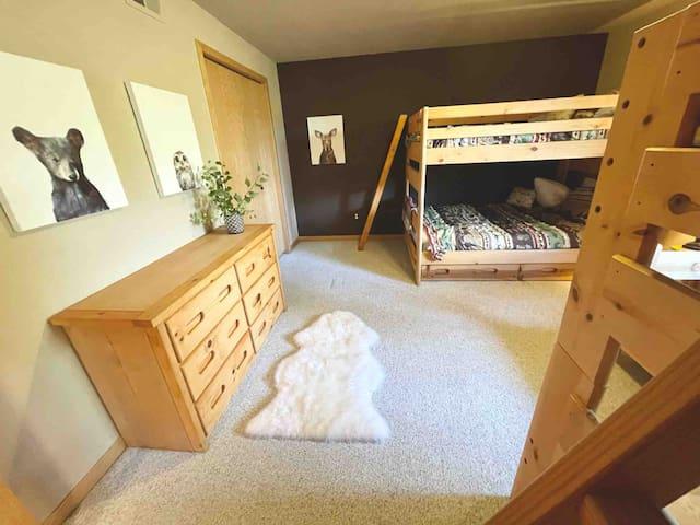Third bedroom with double over double bunk beds, twin over twin bunk beds and additional double trundle and huge walk in closet (sleeps 8 total)