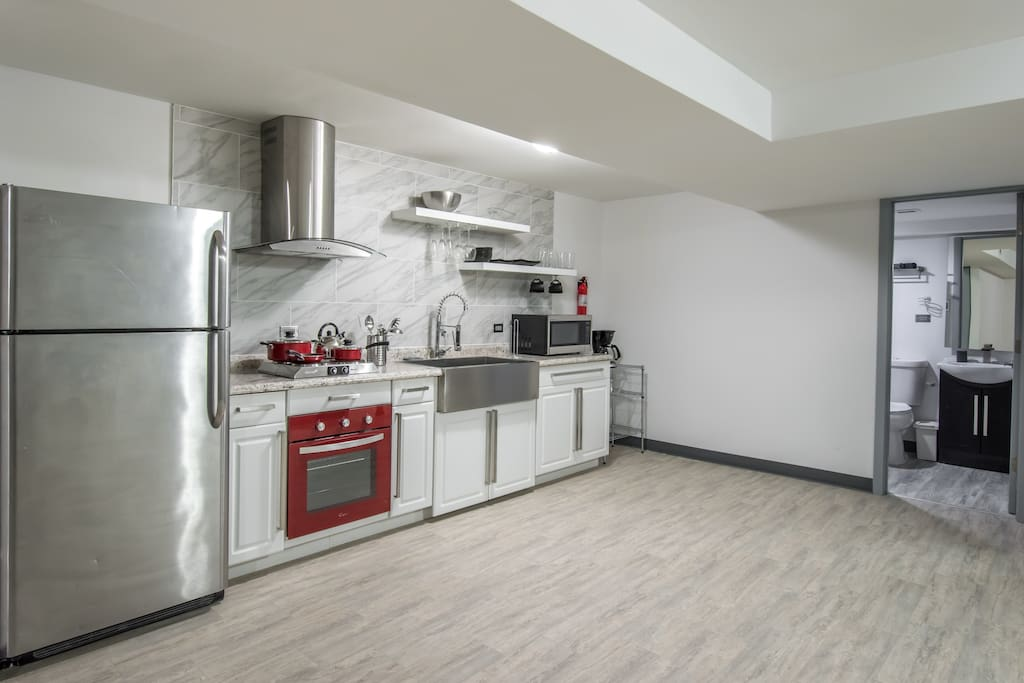 Newly remodeled kitchen with stainless steel appliances, stocked with all supplies needed for a home-cooked meal