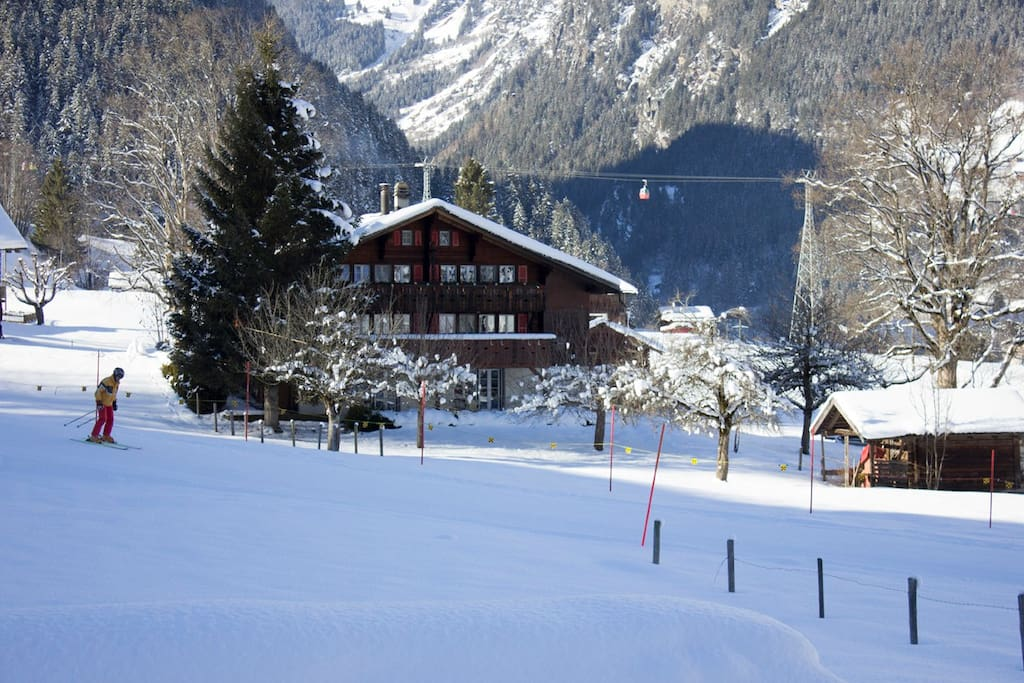 Chalet from the road with skier