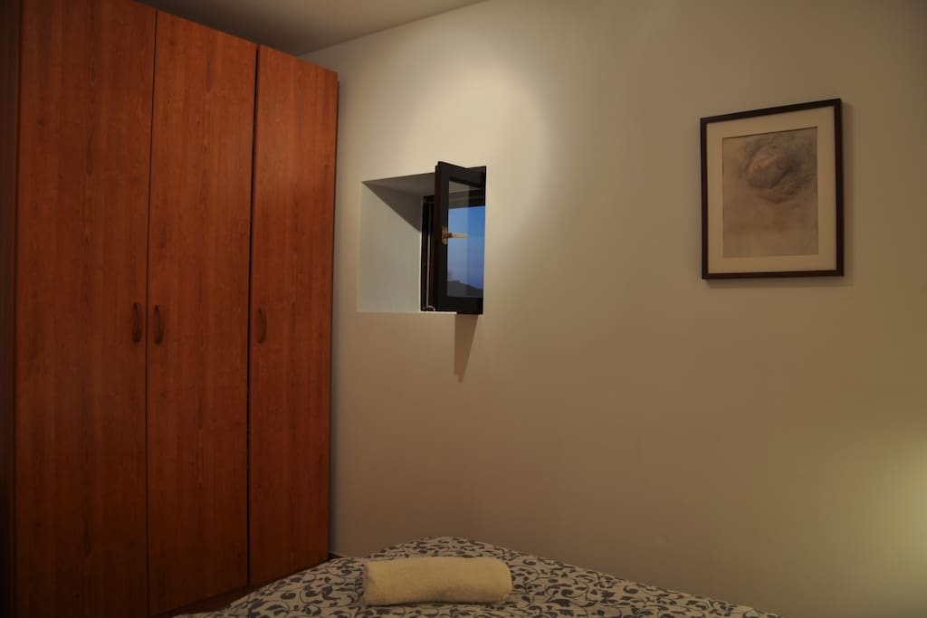 Windows in both bedrooms and bathroom have mosquito nets