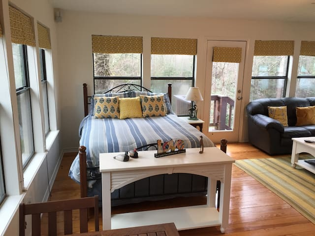 Upstairs queen bed suite with huge couch