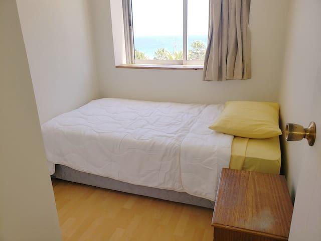 Habitación individual, departamento frente al mar