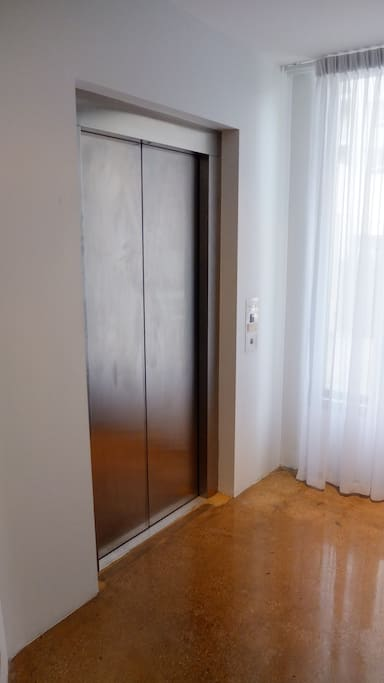 Lift Opens to Apartment