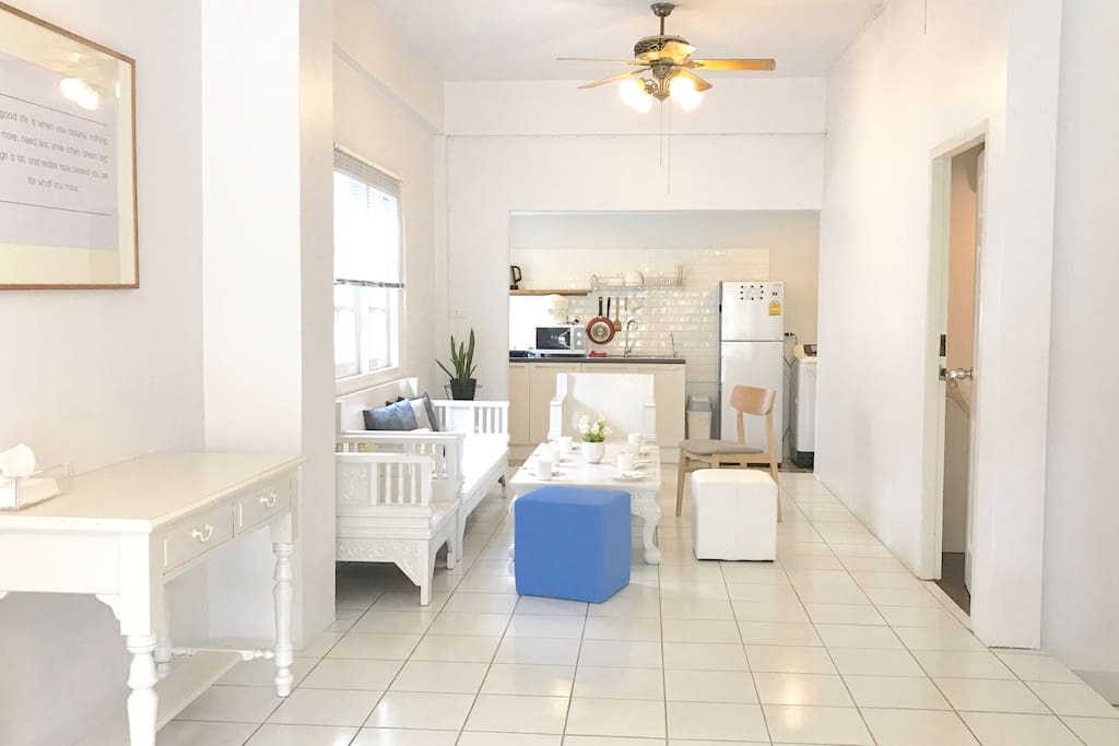 Bright dining area and kitchen with refrigerator,microwave, induction stove, rice cooker, kettle, kitchen utensils and washer. All new.