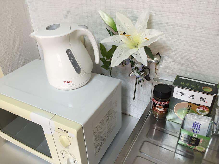 Kettle, microwave, coffee and tea.