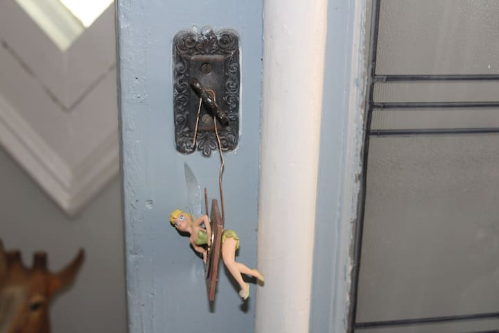 Followed next  by Tinkerbell pointing to  the turn style doorbell
