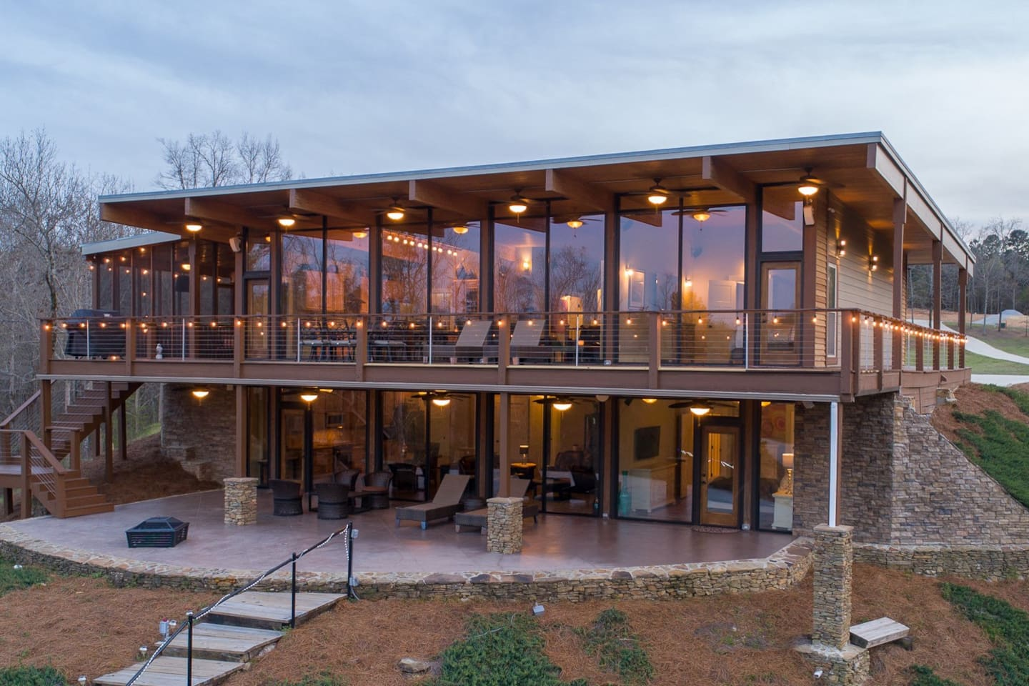 Two levels of floor to ceiling glass perched above Lewis Smith Lake with one of a kind construction and views.