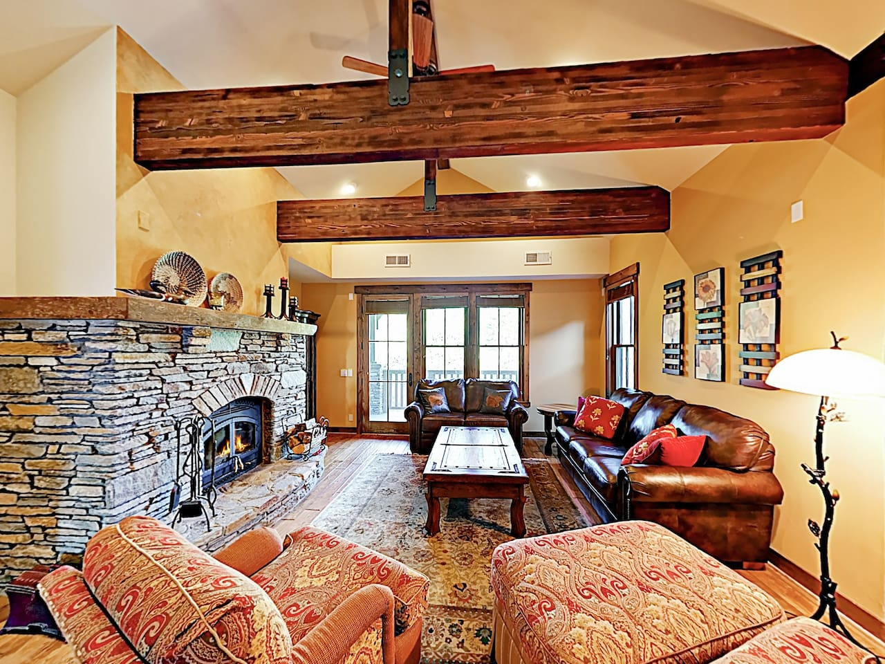 Welcome to Mammoth Lakes! This condo is professionally managed by TurnKey Vacation Rentals. Vaulted ceilings soar in the living room, where a wood-burning rock fireplace sits center stage.
