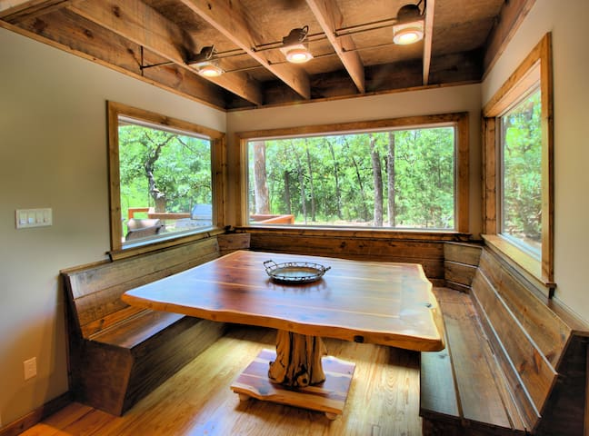 Enjoy a meal and the awesome view at this beautiful handmade table using a tree from the property!!